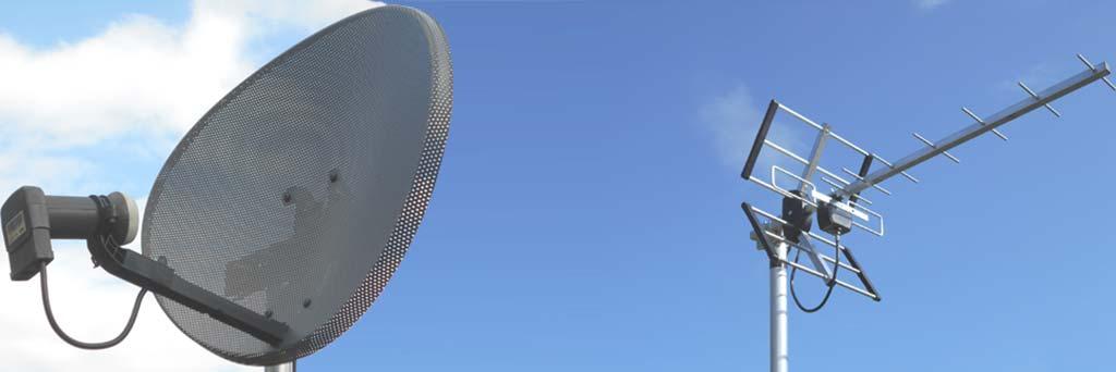 satellite dish and tv aerial blue skies